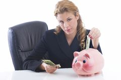 Money maker. Business lady with piggy bank holding dollar bills Royalty Free Stock Photography