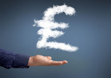 Money making. Conceptual image with cloud pound sign on palm stock photos
