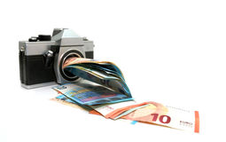 Money making photo camera Royalty Free Stock Image
