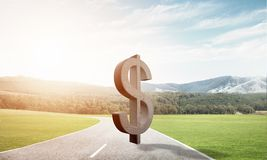 Money making and wealth concept presented by stone dollar symbol on asphalt road Royalty Free Stock Photography