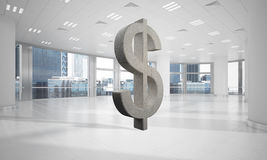 Money making and wealth concept presented by stone dollar symbol in office room. Stone dollar symbol in modern office interior as currency sign. 3d rendering Royalty Free Stock Image