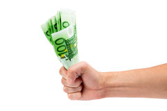 Money in a male fist Royalty Free Stock Image
