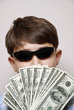 Money Man. Boy holding a fan of one hundred dollar bills Stock Image