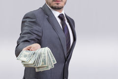 Money man. Businessman showing money to the camera Royalty Free Stock Image