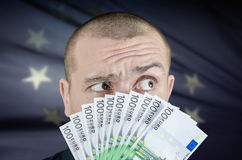 Money. Man gives euro banknotes as a bribe Stock Images