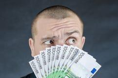 Money. Man gives euro banknotes as a bribe royalty free stock photo