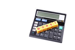 Money management. Money spelled on yellow blocks on the top of calculator Royalty Free Stock Photography