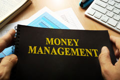 Money management and wealth concept. Book with name money management royalty free stock photo