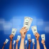 Money in many hands Stock Photos