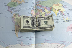 Money on the map. Of world Royalty Free Stock Photography
