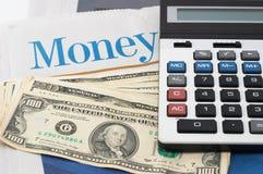 Money Market analysis, calculator, cash. Money Market analysis, calculator, horizontal orientation. closeup, cash, headlines Royalty Free Stock Photography