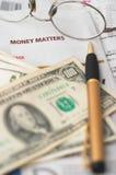 Money Market analysis, calculator, cash. Money Market analysis, calculator, horizontal orientation. closeup, cash, headlines, glasses, shallow depth of field to Stock Photos