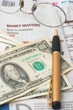 Money Market analysis, calculator, cash. Money Market analysis, calculator, horizontal orientation. closeup, cash, headlines, glasses Royalty Free Stock Photo