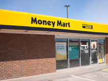Money Mart Storefront. WINDSOR, CANADA - MAY 01, 2016: Money Mart is a Canadian company supplying various financial services. There are approximatly 412 stores royalty free stock images