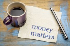 Money matters note on napkin Royalty Free Stock Image