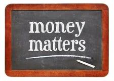Money matters - words on blackboard Royalty Free Stock Image