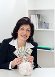 Money mature businesswoman Royalty Free Stock Photography
