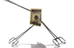 Money in medical clamps Stock Photography