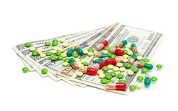 Money and medical drugs on white background Stock Photo