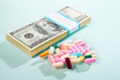 Money and medicine Stock Photo