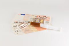 Money and medicines Royalty Free Stock Image
