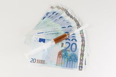 Money and medicines Royalty Free Stock Images