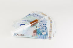 Money and medicines Stock Photo