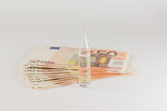 Money and medicines Royalty Free Stock Photos