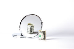 Money in mirror. Transformed to be bigger Stock Image