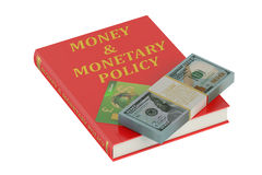 Money and monetary policy concept. On the book Royalty Free Stock Image