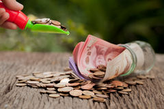 Money and money jar with shovel and cash, Saving money concept, Royalty Free Stock Photography
