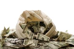 Money!  Money!  Money!. Canvas money bag spilling over with cold hard cash Royalty Free Stock Photography