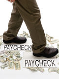Money In, Money Out. Person stepping from paycheck to paycheck with spent money lying crumpled on the ground stock photo
