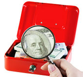 Money in a moneybox. Examines and counts the money in a moneybox Stock Image