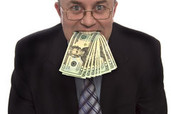Money in mounth. Businessman with money in mouth Stock Photography
