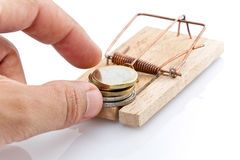 Money on a mousetrap. A stack of Euro coins on a mousetrap Stock Photography