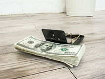 Money in a mousetrap Stock Photography