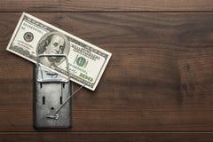 Money mousetrap concept Stock Photos
