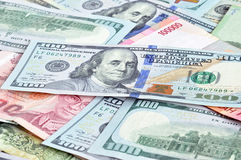 Money in multi currencies with 100 USD bill on top. Money in multi currencies with 100 USD banknote on top Royalty Free Stock Photo