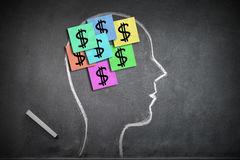 Money on my mind concept with human head shape Royalty Free Stock Image