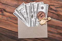 Money near Father`s Day card. Royalty Free Stock Images