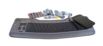Money near to the keyboard and phone. On a white background Stock Photo