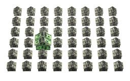 Money neighborhood. A grid of houses made out of 100 dollar American bills with one larger house representing more value or more expense Royalty Free Stock Images