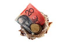 Money in nest Stock Photos