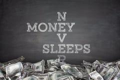 Money never sleeps on blackboard background Royalty Free Stock Images