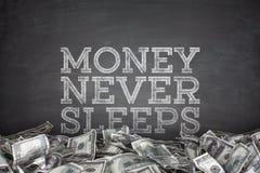 Money never sleeps on blackboard background Stock Photography