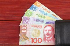 Money from New Zealand in the black wallet Stock Image