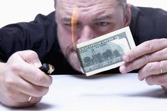 Money is not the best method of  motivation. Close up a man burn Stock Photography