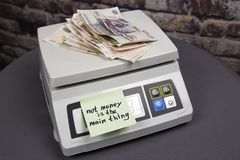 Money is not the main. Thing - the inscription on the paper sticker
