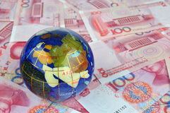 Money note and Globe. A colorful globe and a lot of money note, means fortune, rich, or world wide economy, development and business concept Stock Photos